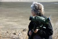 Suzanne bird watching with scope.