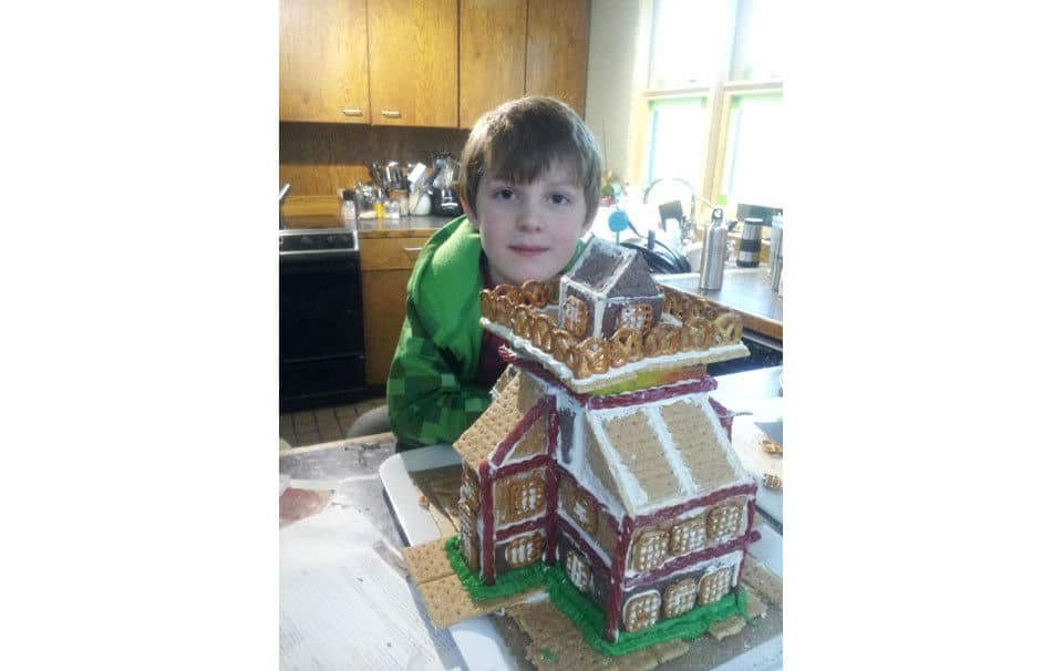 Emmett Wright with the Graham Cracker House.