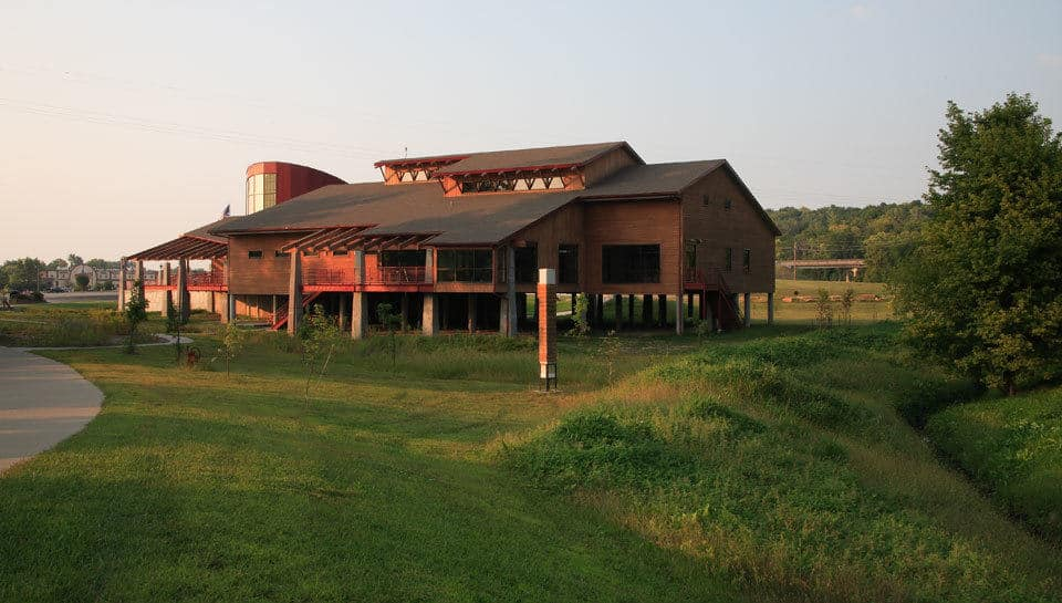 Located in the 100-year flood plain, the Remington Nature Center is raised on 12- to 13-foot piers and has flood proof doors on the lower level storage rooms.