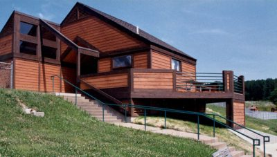 The sloping site of the Beach Change House at Thousand Hills State Park in Kirksville, Missouri is used to great advantage to provide an unobstructed view of the lake.
