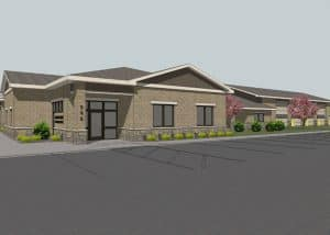The above rendering was developed for the new Audrain Ambulance District Station showing the single story building's exterior consisting primarily of a cultured stone wainscot, decorative concrete masonry veneer and metal siding.