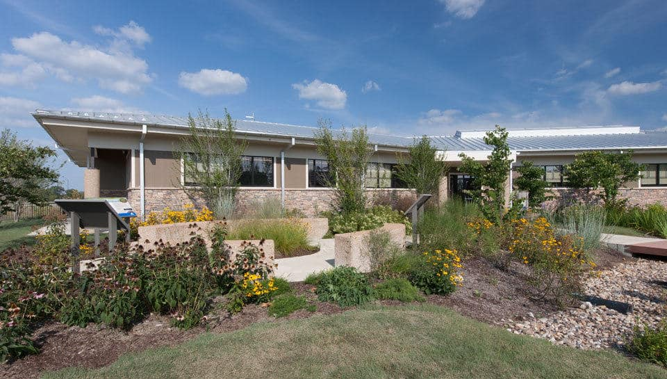 Rain gardens and examples of urban conservation practices are incorporated outside of the Missouri Department of Conservation regional office in Columbia, Missouri.