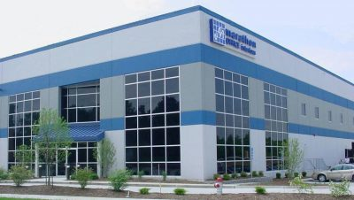 The Marathon Building Environments building is a custom concrete tilt-up building that combines both an office/showroom (8,000 square feet) and a furniture warehouse (10,000 square feet) in one building.