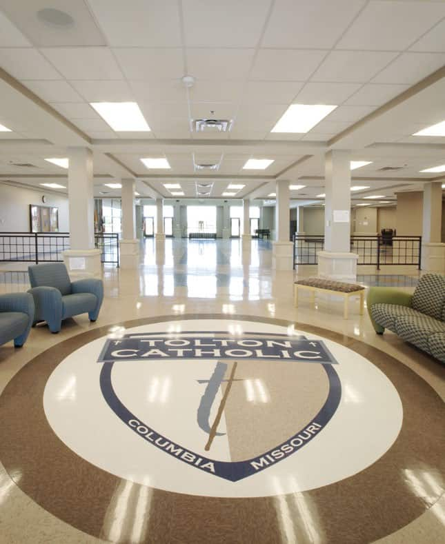 The entryway of the Fr. Tolton Regional Catholic High School displays the schools seal.