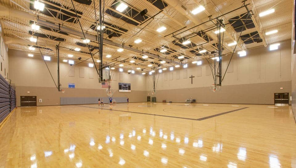 A divider screen can be lowered from the ceiling allowing separate events to take place in the gymnasium simultaneously.
