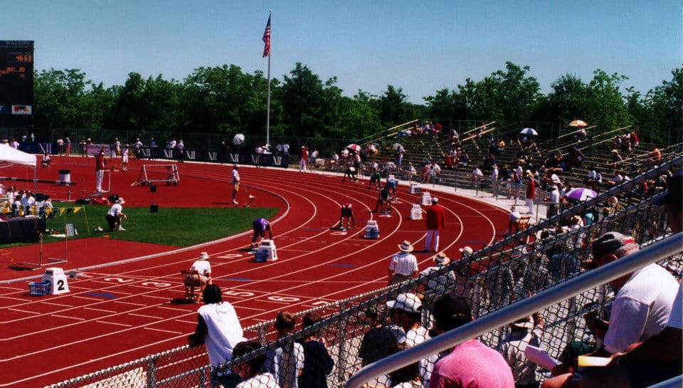 The track surface at the University of Missouri is a combination of red polyurethane and black rubber.