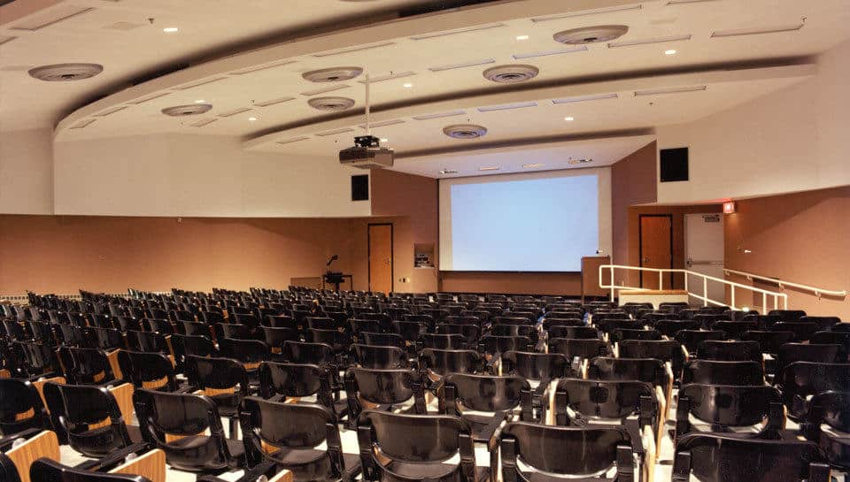 The three-level light system, comprised of cove lights, recessed fluorescent lights, and recessed cans, gives Allen Auditorium a different ambience according to the instructor's needs and wishes.