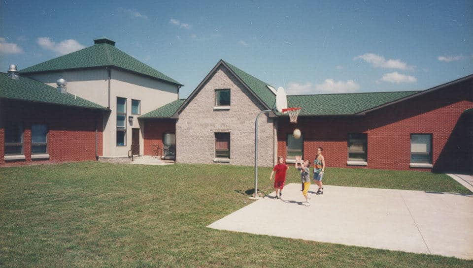 The Butterfield Youth Services Child and Family Therapy Center includes a courtyard recreation area with basketball court. Photograph by Deanna Dikeman