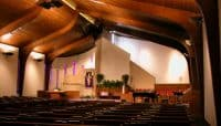 The renovated sanctuary of Calvary Baptist Church in Columbia, Missouri included the re-configuration of the Pulpit, the Lord's supper table, a built-in choir platform and music direction areas.