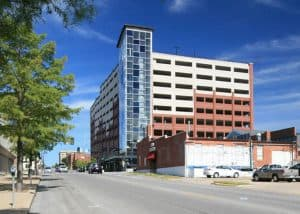 The 8-story Fith and Walnut Parking Garage has about 703 speaces.