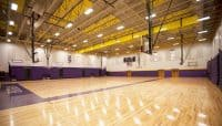 The new gym and classroom addition at Hickman High School includes a competition gym, a 2,200 seat football grandstand, and a two-story building housing classrooms for vocational studies.