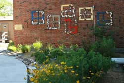 """All Grant School students participated in creating the """"windows"""" sculpture installed on the south wall above the garden and fourth graders collaborated on a poem based on their experiences in the garden."""