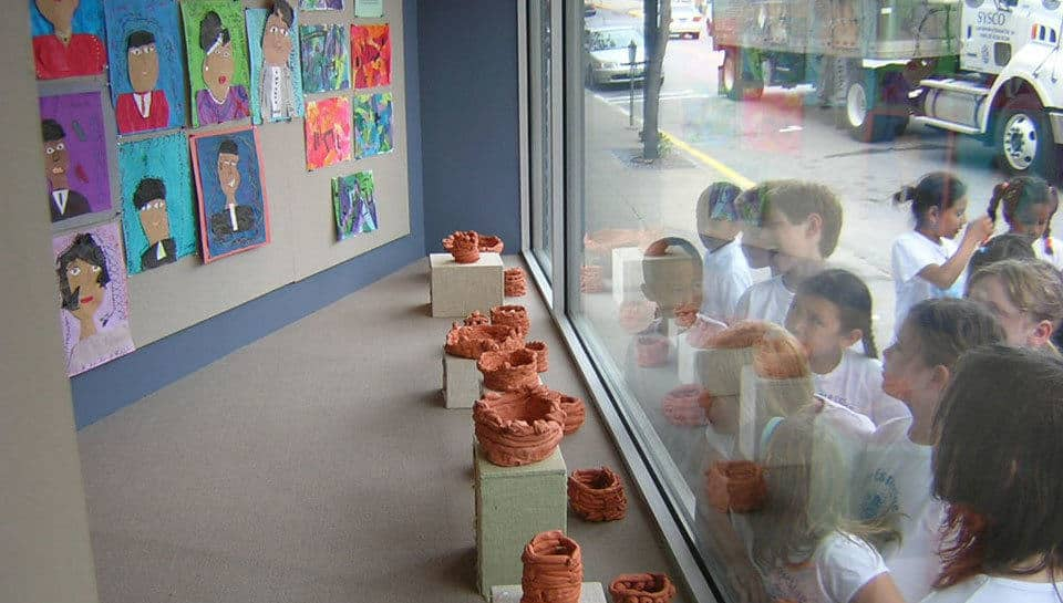 Every May the students from Lee Expressive Schools would visit our downtown office to see their artwork in the Tenth Street Window Gallery.